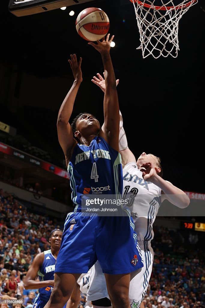Kamiko Williams #4 of the New York Liberty shoots against <a gi-track='captionPersonalityLinkClicked' href=/galleries/search?phrase=Lindsay+Whalen&family=editorial&specificpeople=208984 ng-click='$event.stopPropagation()'>Lindsay Whalen</a> #13 of the Minnesota Lynx during the WNBA game on August 18, 2013 at Target Center in Minneapolis, Minnesota.