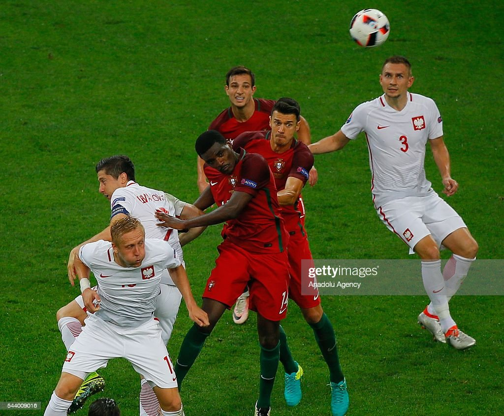 Kamil Glik (15) and Artur Jedrzejczyk (3) of Poland in action against William Carvalho (14) and Jose Fonte (4) of Portugal during the Euro 2016 quarter-final football match between Poland and Portugal at the Stade Velodrome in Marseille, France on June 30, 2016.