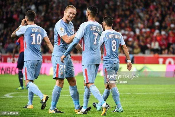 Kamil GLik celebrates a goal with Rachid Ghezzal of Monaco during the Ligue 1 match between Lille OSC and AS Monaco at Stade Pierre Mauroy on...