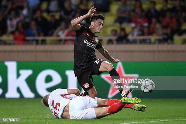Kamil Glik of AS Monaco FC tackles Charles Aranguiz of Bayer 04 Leverkusen during the UEFA Champions League Group E match between AS Monaco FC and...