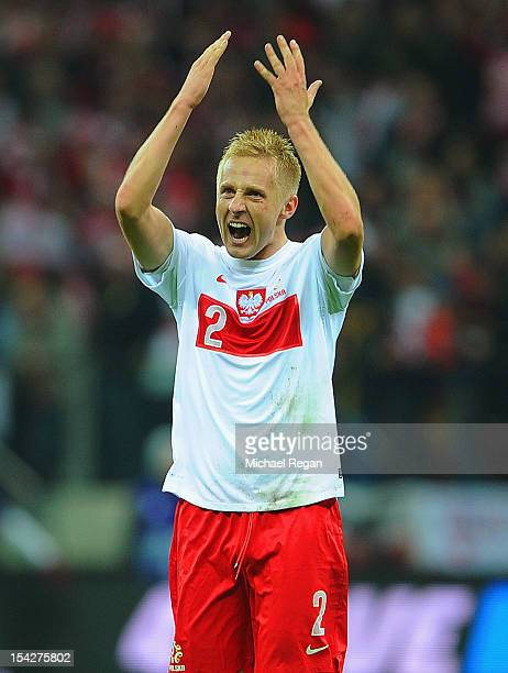Kamil Glik of Poland celebrates scoring to make it 11 during the FIFA 2014 World Cup Qualifier between Poland and England at the National Stadium on...
