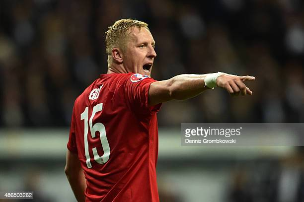 Kamil Glik of Poland gives instructions during the EURO 2016 Qualifier Group D match between Germany and Poland at CommerzbankArena on September 4...