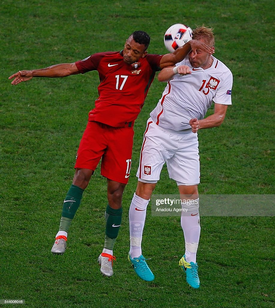 Kamil Glik (15) of Poland in action against Renato Sanches (16) of Portugal during the Euro 2016 quarter-final football match between Poland and Portugal at the Stade Velodrome in Marseille, France on June 30, 2016.