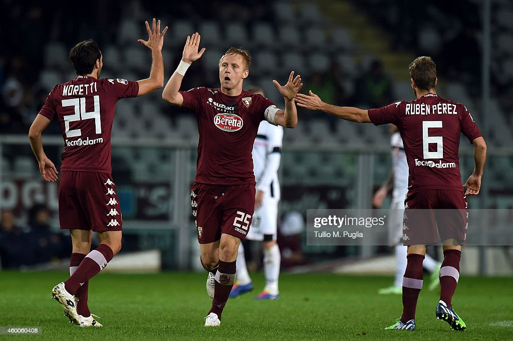 Kamil Glik of Torino celebrates with team mates after scoring the second equalizing goal during the Serie A match between Torino FC and US Citta di Palermo at Stadio Olimpico di Torino on December 6, 2014 in Turin, Italy.