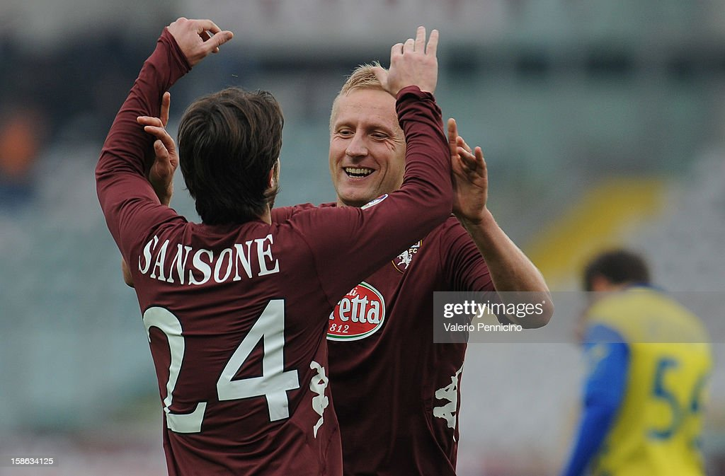 <a gi-track='captionPersonalityLinkClicked' href=/galleries/search?phrase=Kamil+Glik&family=editorial&specificpeople=7029968 ng-click='$event.stopPropagation()'>Kamil Glik</a> (R) of Torino FC celebrates after scoring the opening goal with Gianluca Sansone during the Serie A match between Torino FC and AC Chievo Verona at Stadio Olimpico di Torino on December 22, 2012 in Turin, Italy.