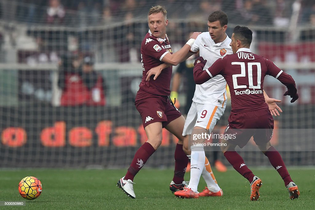 Kamil Glik of Torino FC competes with Edin Dzeko of AS Roma during the Serie A match between Torino FC and AS Roma at Stadio Olimpico di Torino on...