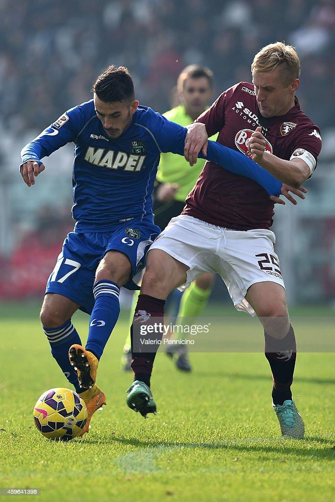Kamil Glik (R) of Torino FC competes with Nicola Sansone of US Sassuolo Calcio during the Serie A match between Torino FC v US Sassuolo Calcio at Stadio Olimpico di Torino on November 23, 2014 in Turin, Italy.