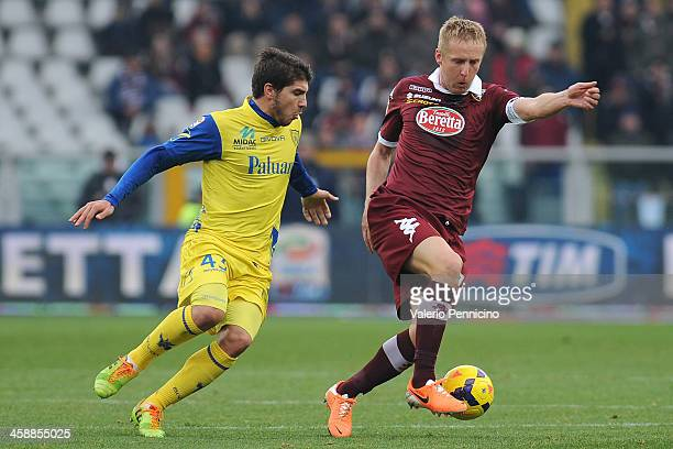 Kamil Glik of Torino FC is challenged by Alberto Paloschi of AC Chievo Verona during the Serie A match between Torino FC and AC Chievo Verona at...