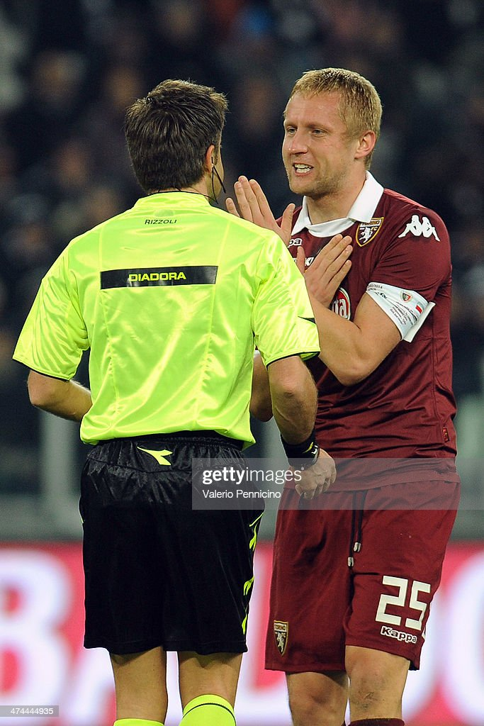 <a gi-track='captionPersonalityLinkClicked' href=/galleries/search?phrase=Kamil+Glik&family=editorial&specificpeople=7029968 ng-click='$event.stopPropagation()'>Kamil Glik</a> of Torino FC reacts to Referee <a gi-track='captionPersonalityLinkClicked' href=/galleries/search?phrase=Nicola+Rizzoli&family=editorial&specificpeople=4238940 ng-click='$event.stopPropagation()'>Nicola Rizzoli</a> during the Serie A match between Juventus and Torino FC at Juventus Arena on February 23, 2014 in Turin, Italy.