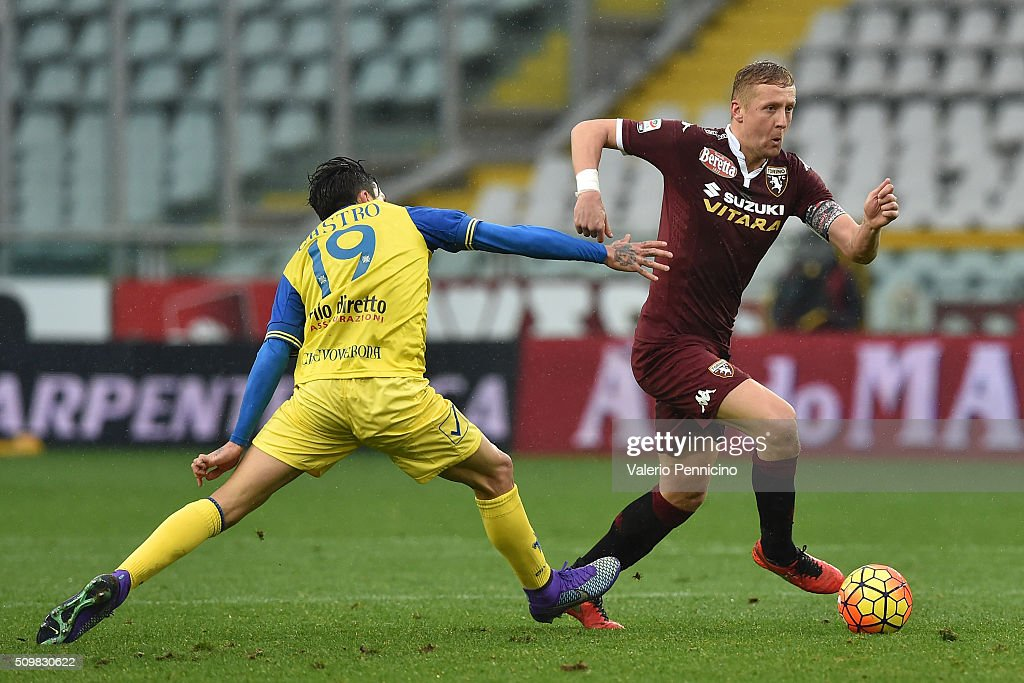 <a gi-track='captionPersonalityLinkClicked' href=/galleries/search?phrase=Kamil+Glik&family=editorial&specificpeople=7029968 ng-click='$event.stopPropagation()'>Kamil Glik</a> (R) of Torino FC turns Lucas Nahuel Castro of AC Chievo Verona during the Serie A match between Torino FC and AC Chievo Verona at Stadio Olimpico di Torino on February 7, 2016 in Turin, Italy.