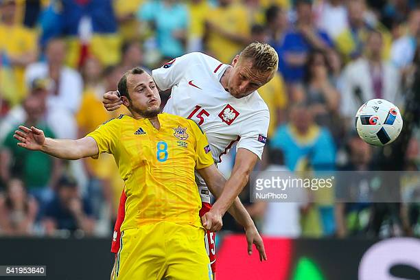 Kamil Glik Roman Zozulya during the UEFA EURO 2016 Group C match between Ukraine and Poland at Stade Velodrome on June 21 2016 in Marseille France