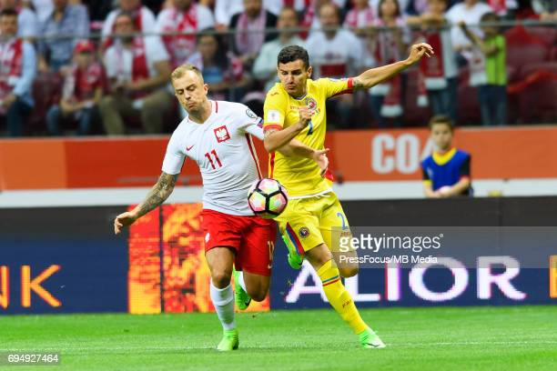 Kamil Grosicki and Romario Benzar during World Cup 2018 qualifier between Poland and Romania on June 10 2017 in Warsaw Poland'n