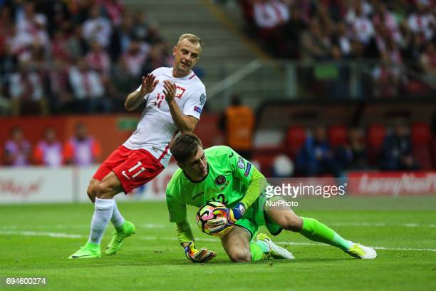 Kamil Grosicki Ciprian Tatarusanu during the FIFA World Cup 2018 qualification football match between Poland and Romania in Warsaw Poland on June 10...