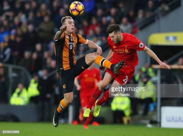 Kamil Grosicki of Hull City and Adam Lallana of Liverpool battle for possession during the Premier League match between Hull City and Liverpool at...