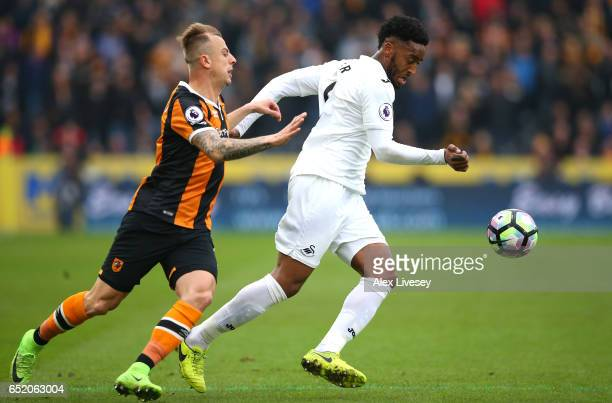 Kamil Grosicki of Hull City and Leroy Fer of Swansea City battle for possession during the Premier League match between Hull City and Swansea City at...