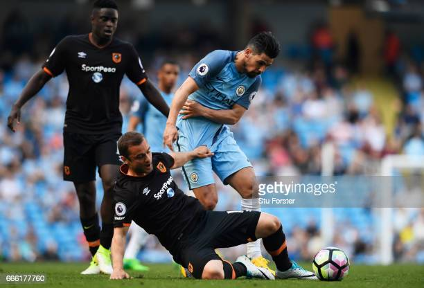Kamil Grosicki of Hull City and Nolito of Manchester City battle for possession during the Premier League match between Manchester City and Hull City...