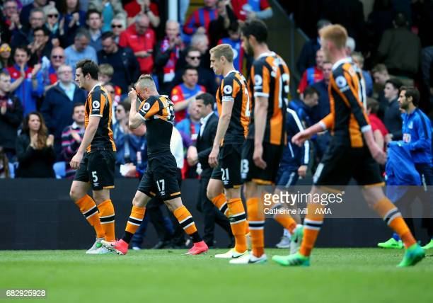Kamil Grosicki of Hull City covers his face as the team trudge off at half time during the Premier League match between Crystal Palace and Hull City...