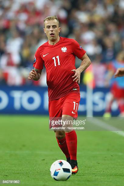 Kamil Grosicki of Poland runs with the ball during the UEFA EURO 2016 Group C match between Germany and Poland at Stade de France on June 16 2016 in...