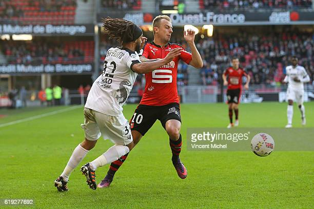 Kamil Grosicki of Rennes and Benoit Assou Ekotto of Metz during the French Ligue 1 match between Rennes and Metz at Stade de la Route de Lorient on...