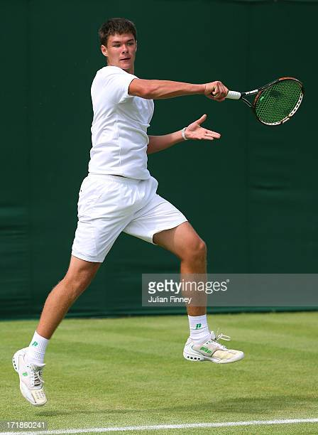 Kamil Majchrzak of Poland plays a forehand during the Boys' Singles first round match against Maximilian Marterer of Germany on day six of the...