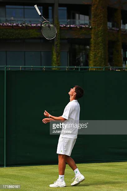 Kamil Majchrzak of Poland throws his racquet in the air during the Boys' Singles first round match against Maximilian Marterer of Germany on day six...