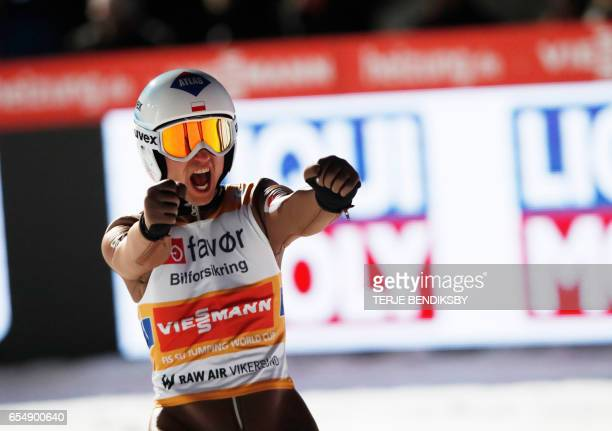 Kamil Stoch from Poland reacts after landing on 243 meters in the 2nd run the FIS Ski Jumping World Cup Men´s Team HS225 in Vikersund on March 18...