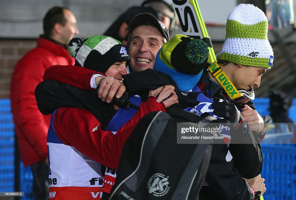 Kamil Stoch of Poland celebrates third place with his team-mates during the Men's Ski Jumping Team HS134 at the FIS Nordic World Ski Championships on March 2, 2013 in Val di Fiemme, Italy.