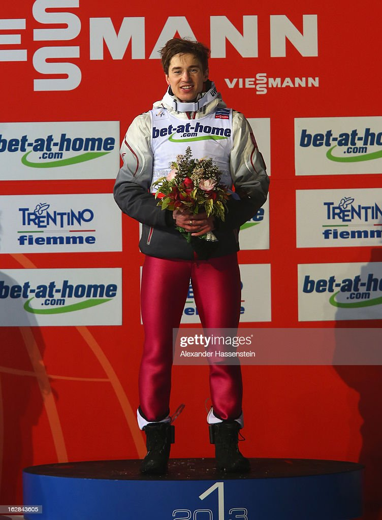 Kamil Stoch of Poland celebrates victory on the podium during the Men's Ski Jumping HS134 Final Round at the FIS Nordic World Ski Championships on February 28, 2013 in Val di Fiemme, Italy.