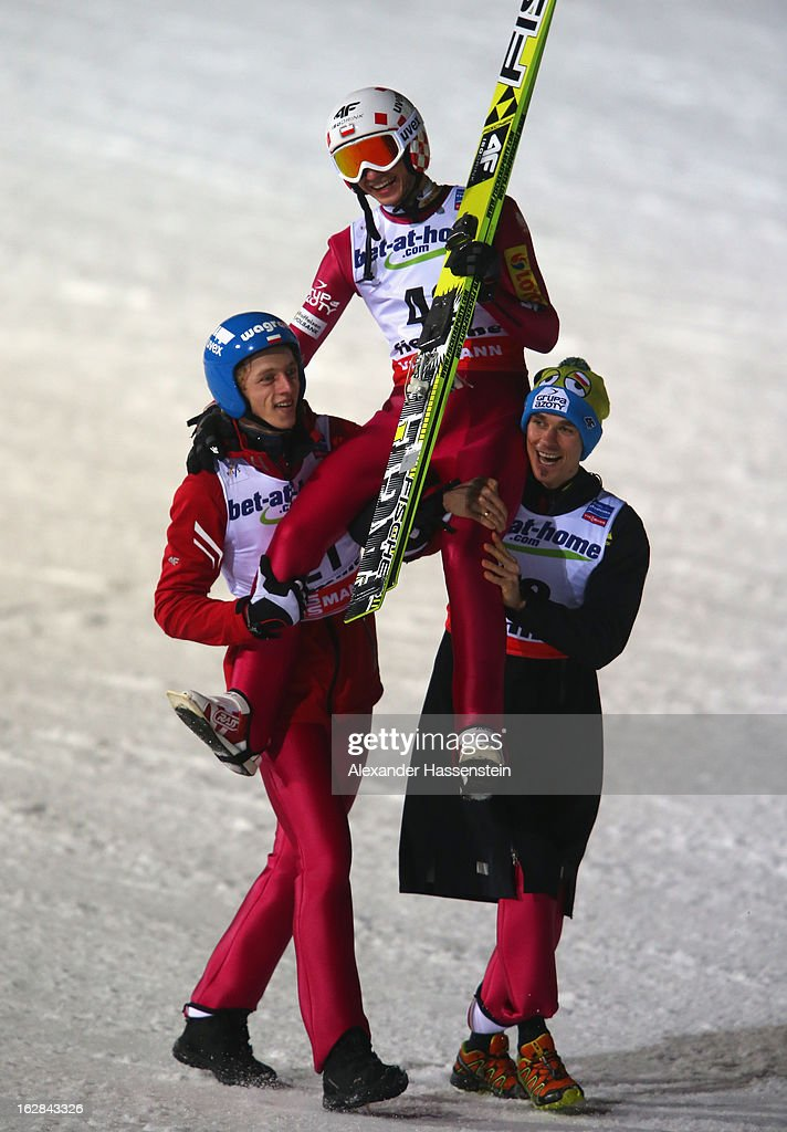 Kamil Stoch of Poland celebrates victory with his team-mates during the Men's Ski Jumping HS134 Final Round at the FIS Nordic World Ski Championships on February 28, 2013 in Val di Fiemme, Italy.
