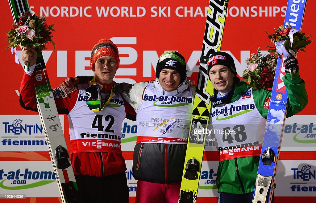 Kamil Stoch of Poland celebrates victory with second placed Peter Prevc of Slovenia (L) and third placed Anders Jacobsen of Norway (R) following the Men's Ski Jumping HS134 Final Round at the FIS Nordic World Ski Championships on February 28, 2013 in Val di Fiemme, Italy.