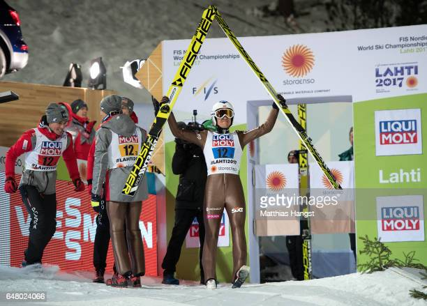 Kamil Stoch of Poland celebrates with his teammates during the Men's Team Ski Jumping HS130 at the FIS Nordic World Ski Championships on March 4 2017...