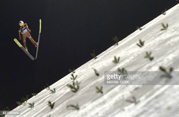 Kamil Stoch of Poland competes during the Four Hills competition of the FIS Ski Jumping World Cup in Bischofshofen on January 6 2017 / AFP / Michal...