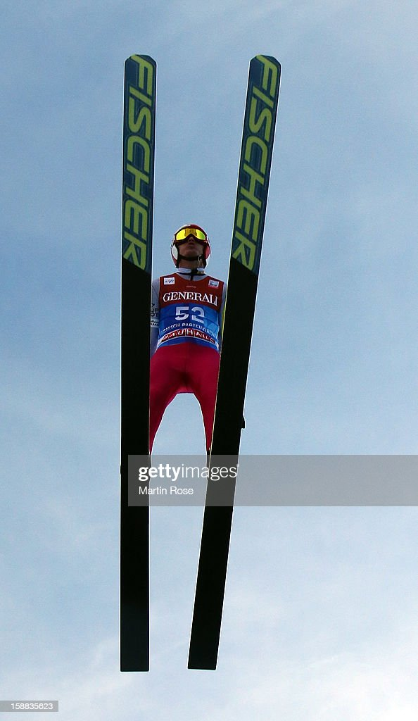 Kamil Stoch of Poland competes during the trial round for the FIS Ski Jumping World Cup event of the 61st Four Hills ski jumping tournament at Olympiaschanze on December 31, 2012 in Garmisch-Partenkirchen, Germany.