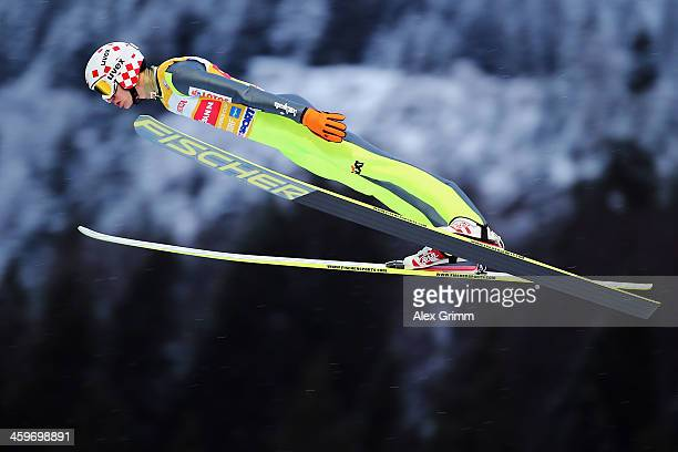 Kamil Stoch of Poland competes during the trial round on day 2 of the Four Hills Tournament Ski Jumping event at SchattenbergSchanze on December 29...