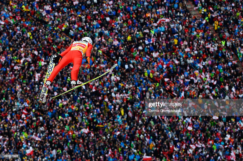 <a gi-track='captionPersonalityLinkClicked' href=/galleries/search?phrase=Kamil+Stoch&family=editorial&specificpeople=820513 ng-click='$event.stopPropagation()'>Kamil Stoch</a> of Poland soars through the air during his first round jump on day 2 of the Four Hills Tournament event at Bergisel on January 4, 2014 in Innsbruck, Austria.