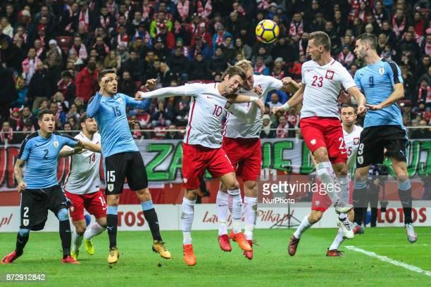 Kamil Wilczek Grzegorz Krychowiak Kamil Glik Matias Vecino in action during the international friendly match between Poland and Uruguay at National...