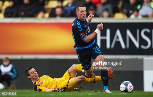 Kamil Wilczek of Brondby IF and Conor O´Brien of AC Horsens compete for the ball during the Danish Alka Superliga match between AC Horsens and...