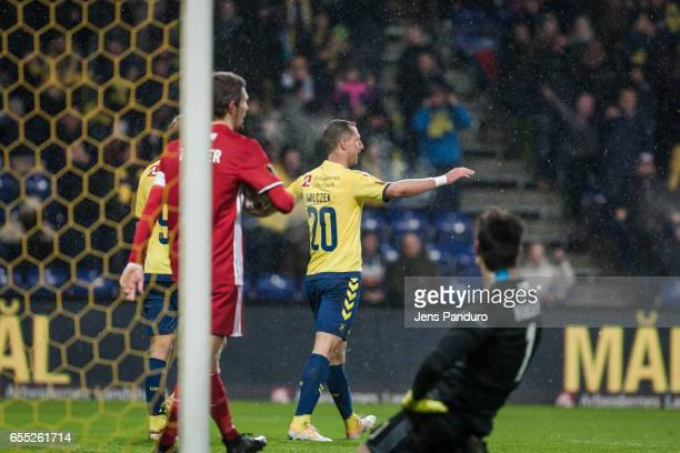Kamil Wilczek of Brondby IF overuns Goalkeeper Jesper Hansen of Lyngby BK and scores the Danish Alka Superliga match between Brondby IF and Lyngby BK...