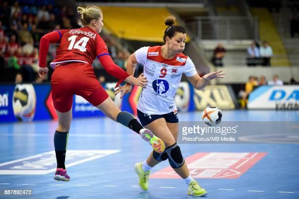 Kamila Kordovska of Czech Republicand Nora Mork of Norway vie for the ball during IHF Women's Handball World Championship group B match between Czech...
