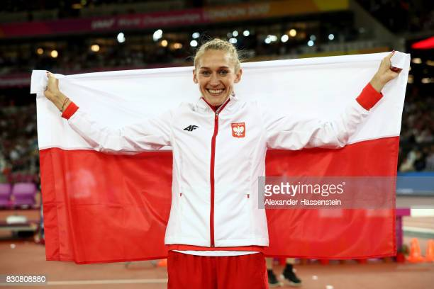 Kamila Licwinko of Poland celebrates with a flag after winning bronze in the Women's High Jump Final during day nine of the 16th IAAF World Athletics...