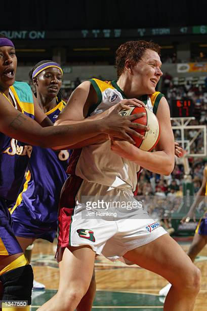 Kamila Vodichkova of the Seattle Storm battles for possesion against Latasha Byears of the Los Angeles Sparks during Game one of the Western...