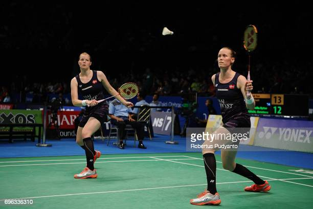 Kamilla Rytter Juhl and Christinna Pedersen of Denmark compete against Poon Lok Yan and Tse Ying Suet of Hong Kong during Womens Double Round 2 match...