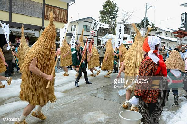 Kaminoyama Japan Participants dressed in traditional straw coats dance to taiko drumming during the 'Kasedori Festival' in Kaminoyama Yamagata...