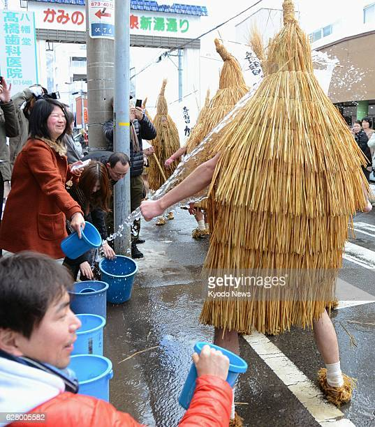 Kaminoyama Japan People in Kaminoyama Yamagata Prefecture northeastern Japan splash cold water onto a procession of youngsters dressed in traditional...