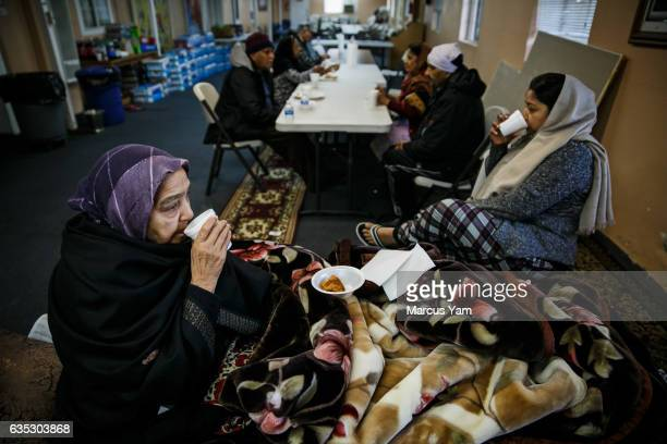 Kamlesh Nahar left and her daughter Manita Sidhu right sip on chai tea for breakfast as they wake up from spending the night at the Shri Guru...