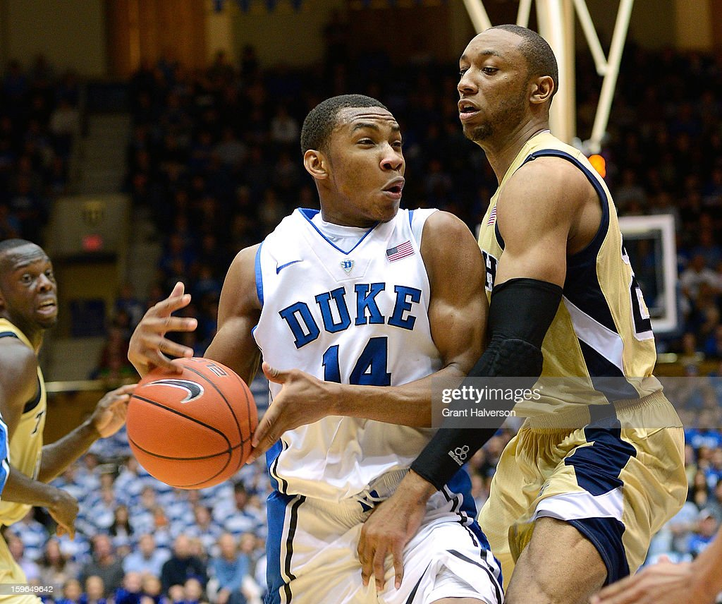 Kammeon Holsey #24 of the Georgia Tech Yellow Jackets knocks the ball away from Rasheed Sulaimon #14 of the Duke Blue Devils during play at Cameron Indoor Stadium on January 17, 2013 in Durham, North Carolina. Duke won 73-57.