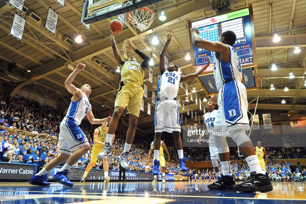 Kammeon Holsey #24 of the Georgia Tech Yellow Jackets puts up a shot against Amile Jefferson #21 of the Duke Blue Devils at Cameron Indoor Stadium on January 17, 2013 in Durham, North Carolina. Duke defeated Georgia Tech 73-57.
