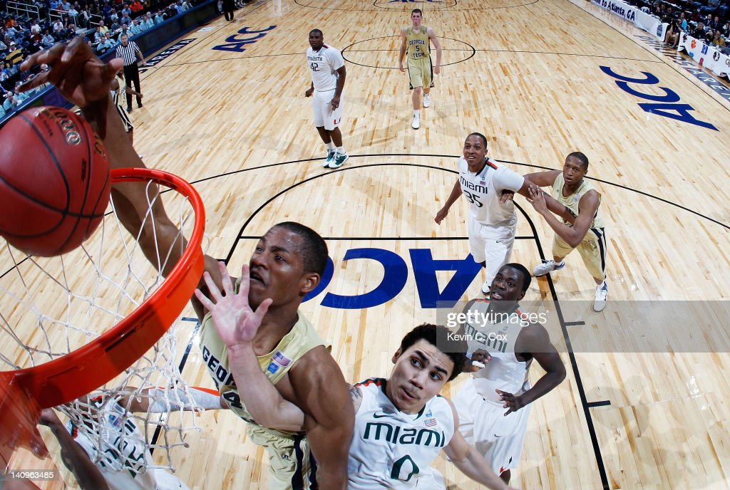 Kammeon Holsey #24 of the Georgia Tech Yellow Jackets shoots over Shane Larkin #0 of the Miami Hurricanes during their first round game of 2012 ACC Men's Basketball Conferene Tournament at Philips Arena on March 8, 2012 in Atlanta, Georgia. The Hurricanes defeated the Yellow Jackets 54 to 36.