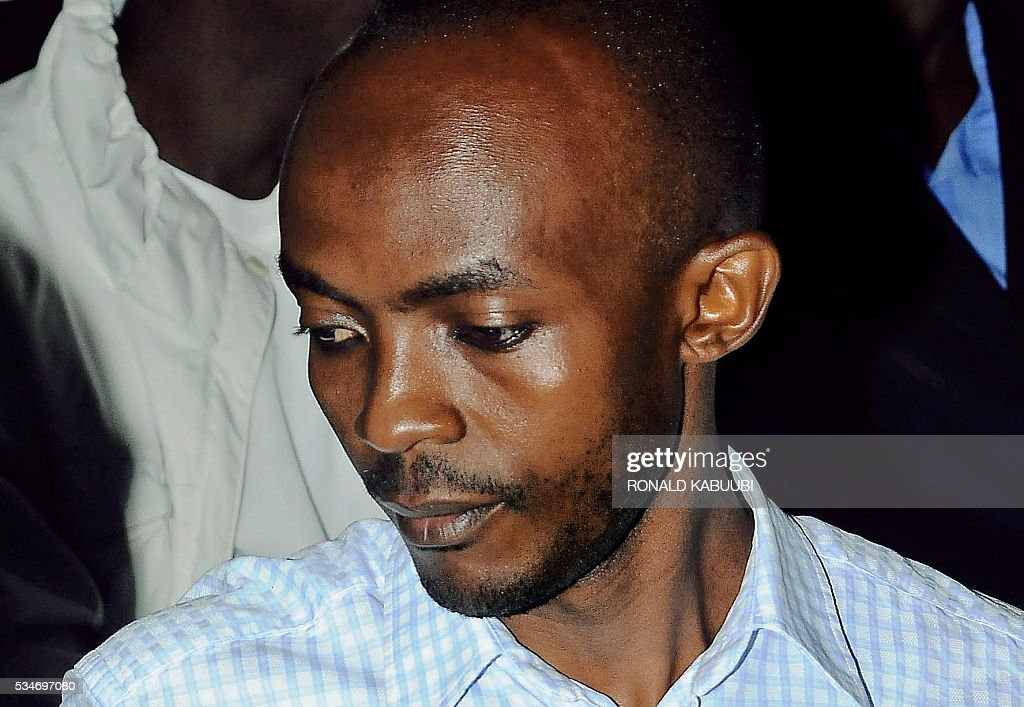 Kampala 2010 World Cup bombing suspect, Issa Luyima, who was considered the mastermind behind the attacks, sits in Kampala High Court, on May 27, 2016. Luyima was sentenced to life in prison for the twin bombings which targeted football fans in Kampala and killed 76 people. Four accomplices also received life terms for the 2010 suicide attacks, while two others received 50-year sentences. The attacks claimed by Somalia's Shebab jihadist group. / AFP / RONALD