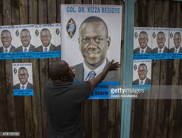 A supporter of Dr Col Kizza Besigye poses near his campaign poster at the Forum for Democracy Change offices in Kampala on July 1 after Besigye was...